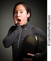 Female fencer looking shock with hand on cheek