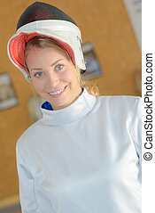 Female fencer with visor raised