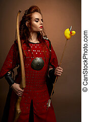 Female fighter in red armor keeping dow and rubber duck