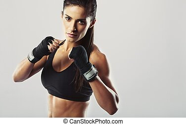 Female fighter posing in combat pose - Pretty young woman...