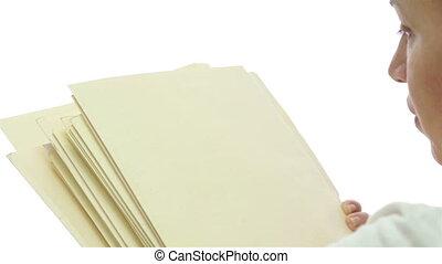 Female File Folders Over Shoulder - Over the shoulder shot...