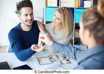 Female financial advisor working with couple