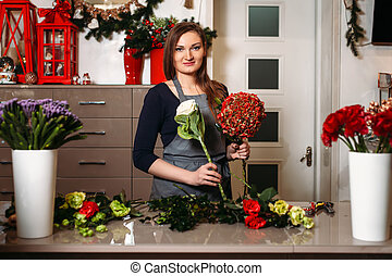 Female florist create beautiful bouquet