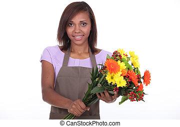 female florist holding bouquet