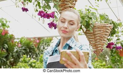 Female florist makes selfie at the garden centre