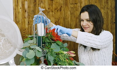 Female florist making flower arrangements