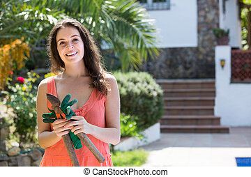 Female florist working in the garden