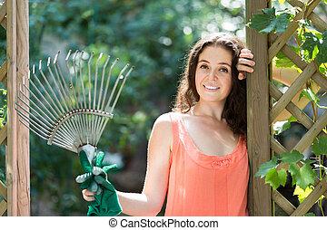 Female florist working in the garden