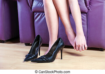 female foot massage - woman give herself foot massage