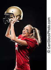 Female football player cheering with helmet