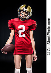 Female football player in helmet