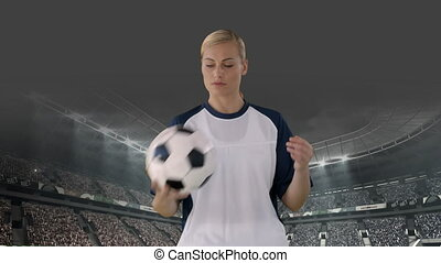 Female football player playing with ball