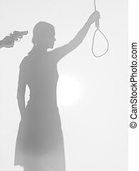 female body silhouette holding a strangling rope while beeing threatened with a gun, behind a diffuse surface