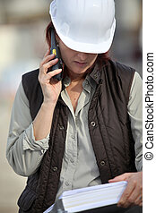 Female foreman with radio receiver