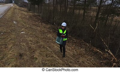 Female forestry inspector checking felling bushes