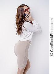 female formal wear - Beautiful businesswoman is talking on...
