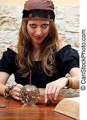 female fortune teller looks to the viewer - Soothsayer...