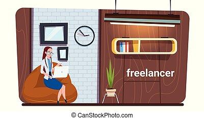 Female Freelance Worker Using Laptop Computer Work In Modern...