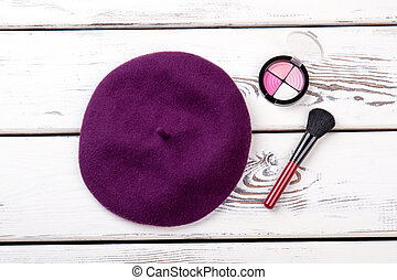 Female french beret and cosmetics.