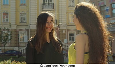 Female friends chatting on the street