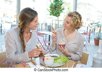 female friends having lunch together at a restaurant