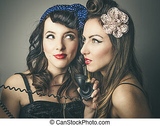 Female friends in vintage clothes with telephone