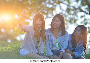 Female Friends Laughing and Looking at Cell Phone