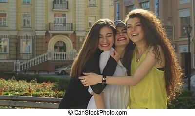 Female friends meet on the street