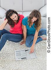 Female friends reading a book in th