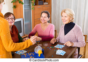 female friends sitting with lotto