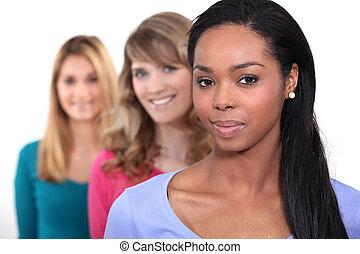Female friends stood in a row