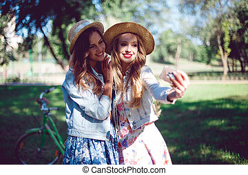 Female friends taking selfie at a national park.