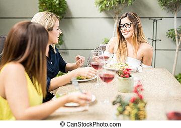 Female friends talking in a restaurant
