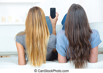 Female friends using a mobile phone