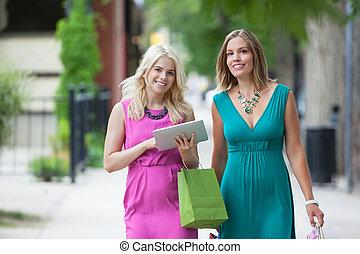 Female Friends Using Digital Tablet