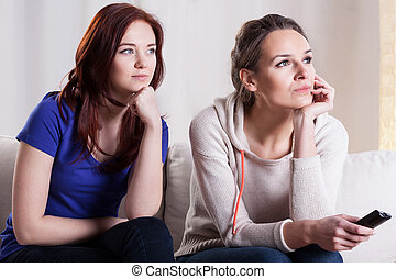Female friends watching movie