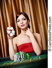 Female gambler keeps chips in hand
