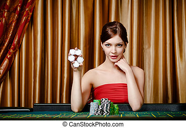 Female gambler shows chips in hand