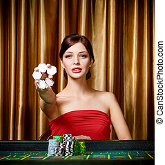 Female gambler with chips in hand