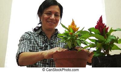 Female Gardener Green Thumbs Up - Female gardener against an...