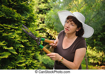 Female gardener with clippers