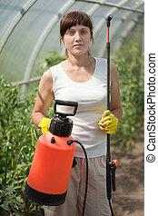 Female gardener   with  garden spray