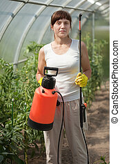 Female gardener   with  garden spray