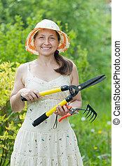 Female gardener with garden tools