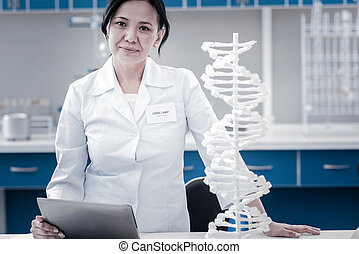 Female genetic scientist posing for camera in laboratory -...