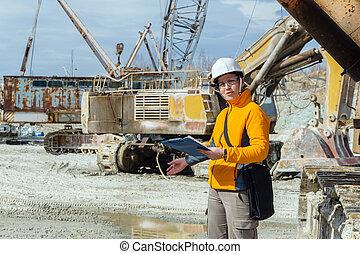 female geologist or mining engineer at work