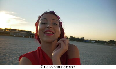 Female girl taking selfie in vacation on the beach at sunrise