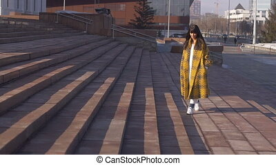 Female going up on stairs - Female wearing yellow checkered...