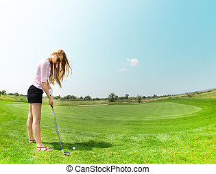 Female golf player at the course