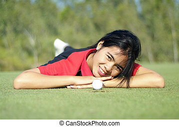 Female golf player on green